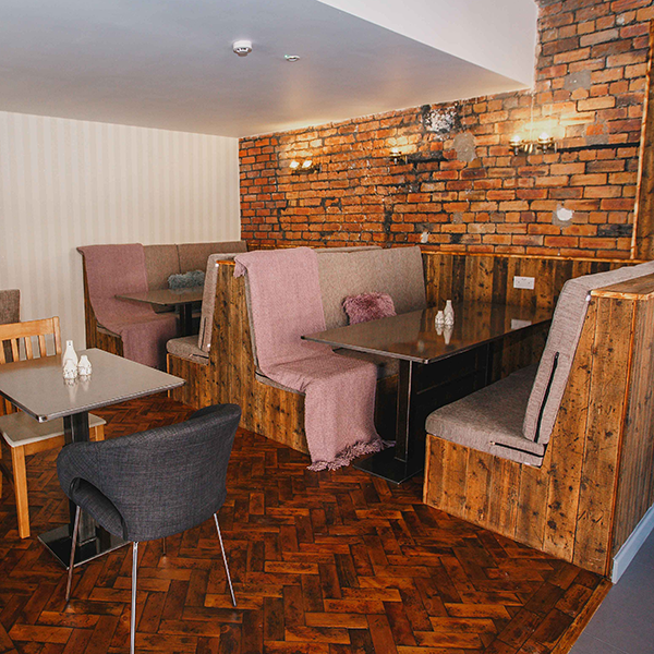 Cosy booths at The Glost House Cafe Bar in Longton, Stoke-on-Trent, Staffordshire